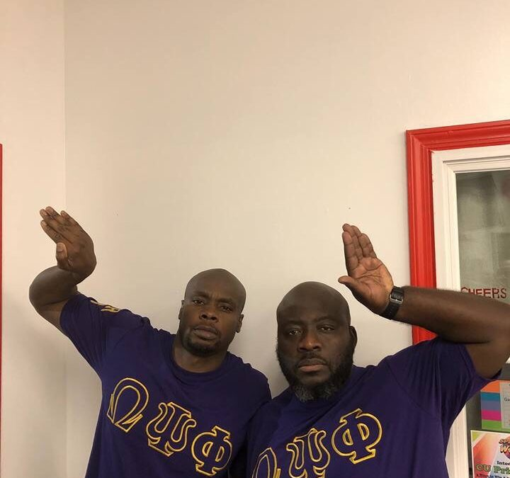 Epsilon Alpha Alpha of Omega Psi Phi crosses two new members.